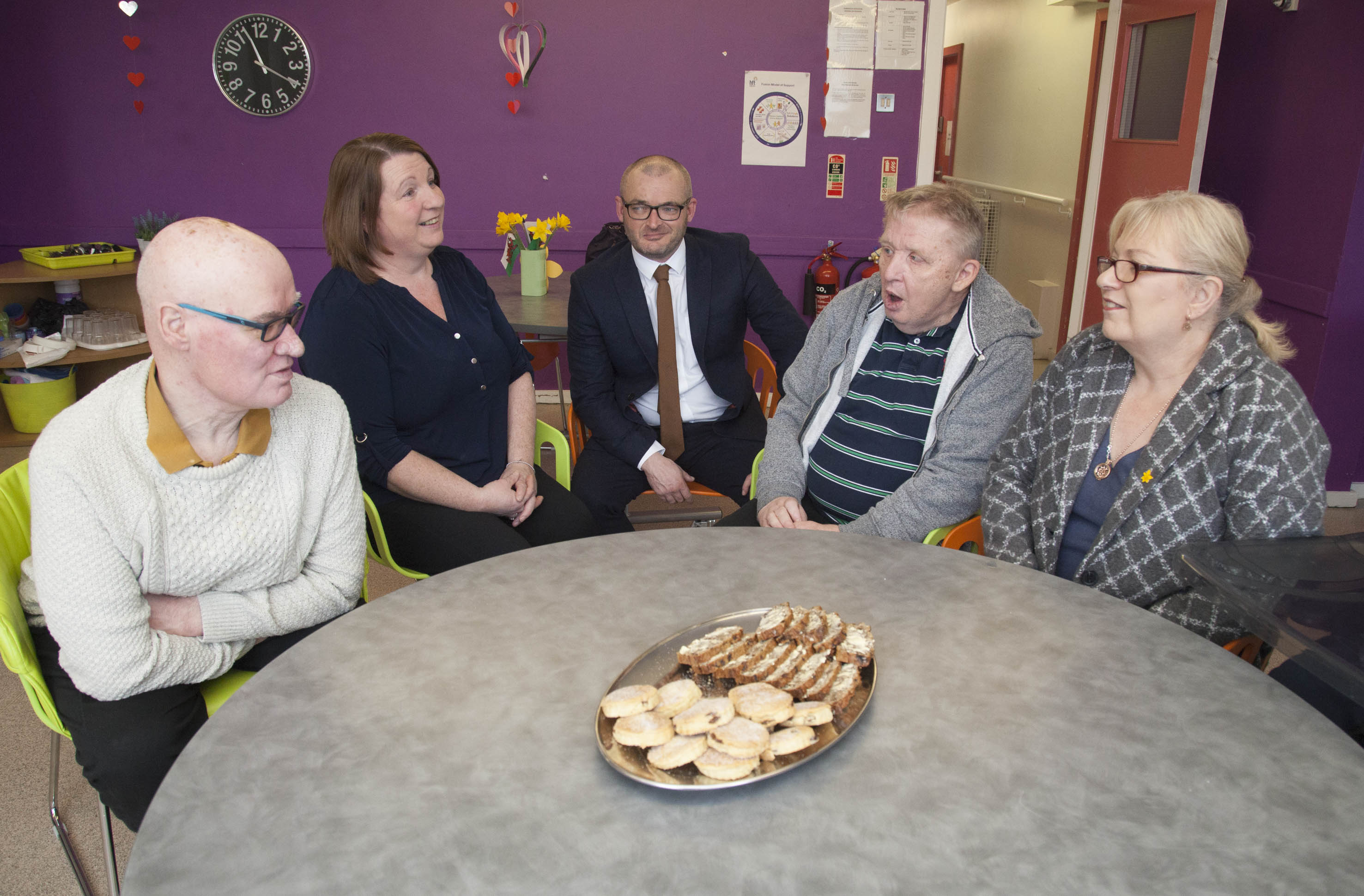 Cllr Christine Jones and Leader of the Council Cllr Aaron Shotton talk to service users Michael Hodson and John Freeman along with Hft's Maria Williams