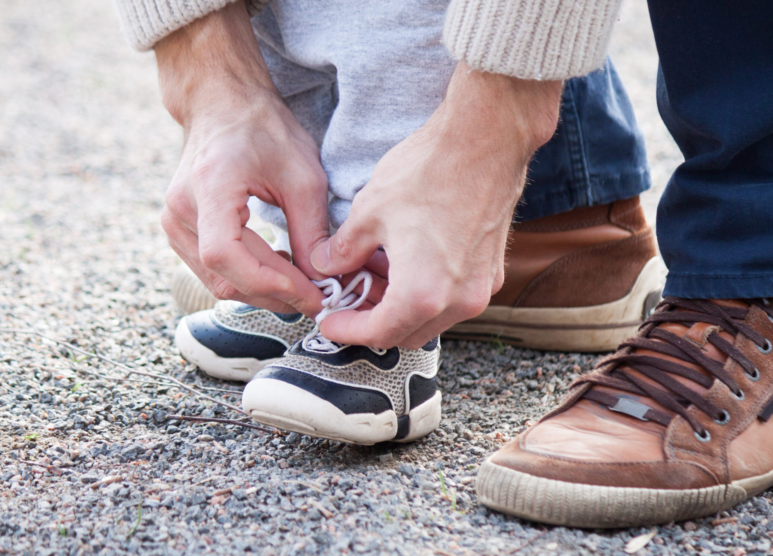 Dad-tying-childs-shoe-lace--scaled (1).jpg
